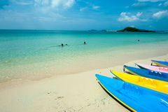 Many size and colorful of kayak in blue sky ,people swim in  clear sea in popular beach during holiday Royalty Free Stock Photo