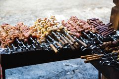 Meat and potatoes prepared for frying on skewers. Stock Images