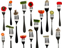 Many slice of vegetables in forks Stock Image