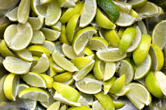 Many sliced lime background. Many sliced green lime background Stock Photo