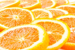 Many sliced oranges Stock Images