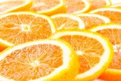 Many sliced oranges Stock Images