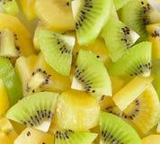 Many slices of kiwi fruit on background.  Stock Photos