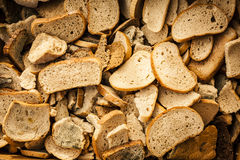 Many slices of stole dry bread. Royalty Free Stock Photos
