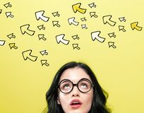 Many small arrows with young woman stock image