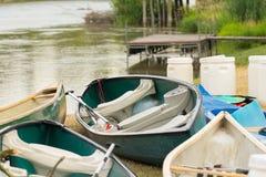 Many small boats on riverbank Royalty Free Stock Photo