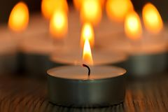 Many small burning candles Stock Photos