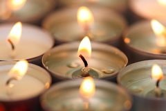 Many small burning candles Stock Photo