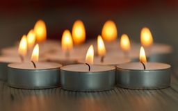 Many small burning candles Stock Images