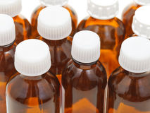 Many small closed brown glass pharmacy bottles Royalty Free Stock Photos