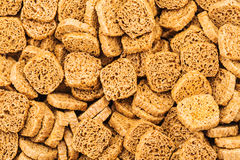 Many small dried rusks  as texture background. Many small dried rusks bread loaf toast biscuits as texture background. Diet food healthy nutrition Stock Photos