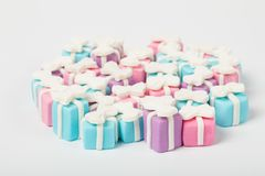 Many small gifts, sugar confectionery. Very small gifts, sugar confectionery stock images