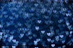 Many small glowing hearts. Many small glowing blue hearts royalty free stock photos