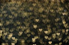 Many small glowing hearts. Many small yellow hearts stock image
