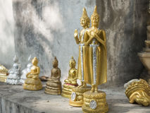 Many small golden Buddha statue on the conner of  old Chape Stock Photo