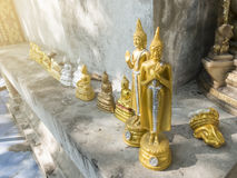 Many small golden Buddha statue on the conner of  old Chape Royalty Free Stock Image
