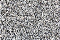 Many small and gray stones. Ground stone grey background of many small stones Stock Image