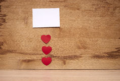 Many small hearts and a blank sheet of paper to record Royalty Free Stock Images