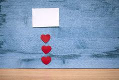 Many small hearts and a blank sheet of paper to record Royalty Free Stock Photos