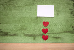 Many small hearts and a blank sheet of paper to record Stock Photo