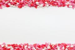 Many small hearts on the top and bottom on a white background Stock Image