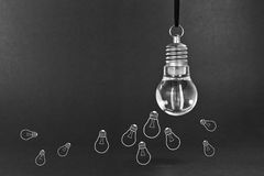 Many small ideas. Concept with light bulb stock photo