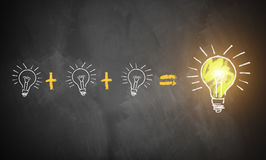 Many small ideas leading to the big picture. Symbolized by lightbulbs drawn on a chalkboard Stock Photography
