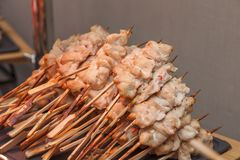 Many small kebabs with salmon fish Royalty Free Stock Photography