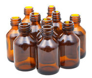 Many small open amber glass oval pharmacy bottles Royalty Free Stock Images