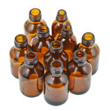 Many small open brown glass oval pharmacy bottles Royalty Free Stock Images
