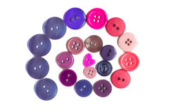 Many small original buttons. Many original buttons isolated on white background Stock Photography