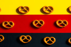 Many small pretzels  on a background of the German flag colors Royalty Free Stock Photos