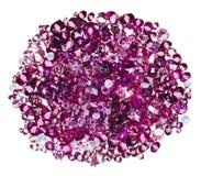 Many small ruby diamond (jewel) stones heap. Isolated on white Royalty Free Stock Photos
