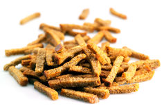 Many small salty dried rusks isolated on white. Many small salty dried rusks Royalty Free Stock Image