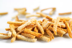 Many small salty dried rusks on white Stock Photo