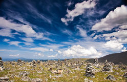 Small stone piles on mountain Stock Images