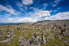 Small stone piles on mountain Stock Photo