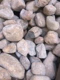 Many small to medium size stones. Uneven rough stones isolated stock image