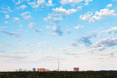 Many small white clouds in blue sky over city Stock Photos