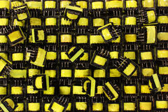 Many small yellow electrical ferrite transformers Royalty Free Stock Photography
