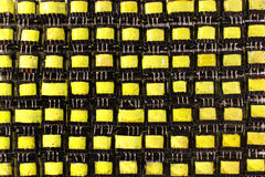Many small yellow electrical ferrite transformers Royalty Free Stock Images
