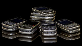 Many smart phones in a pile Stock Photo