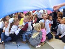 Many children playing on celebrate indoor. Many smiling children playing on celebrate indoor in Russia Stock Photo