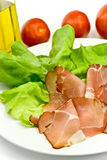 Many smoked slices of ham with salad Royalty Free Stock Image
