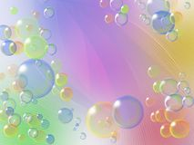 Soap bubbles on a gentle colored background Stock Image