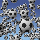 Soccer balls on blue sky background Stock Images
