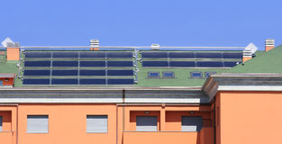 Many solar collectors. Solar collectors, used for hot water production, on a big roof Stock Photo