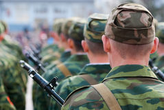 Many soldiers, rear view Royalty Free Stock Image