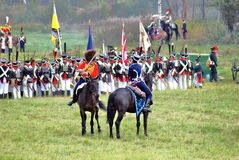 Many soldiers-reenactors fight on the battle field. Royalty Free Stock Images