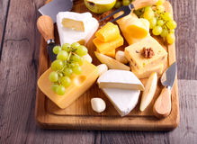 Many sorts of cheese with fruits. Over wooden board Stock Photo